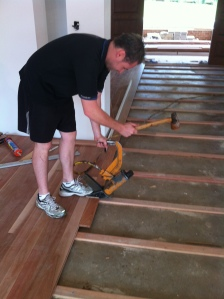 floor layer installing timber flooring